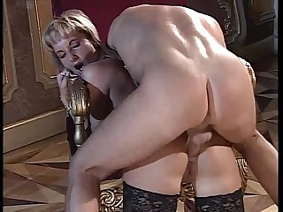 Noblewoman gives a blowjob to an employee